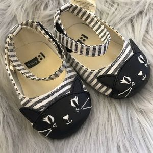 Baby girl shoes. Cats